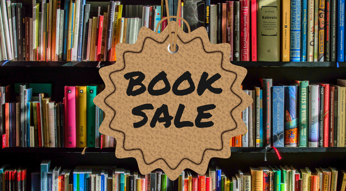 Book Sale sign over books on a shelf