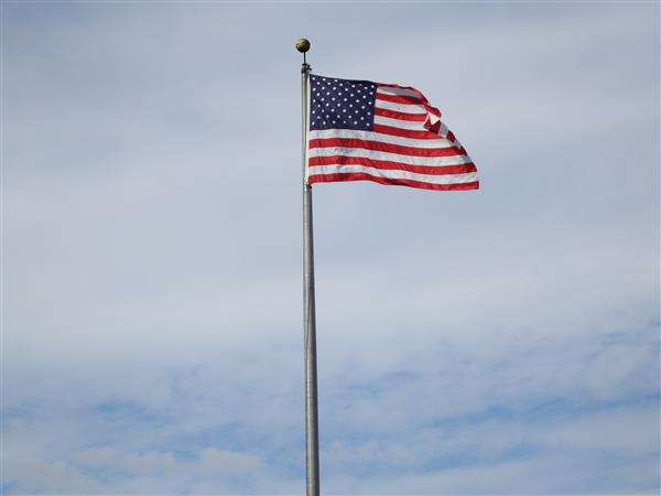 Flag flying above a Framingham School