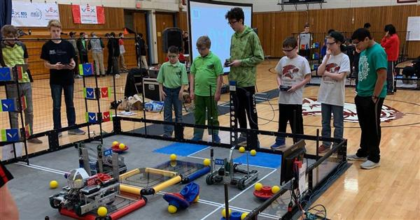 Photo shows teams from Locke Middle School and Walsh Middle School playing Turning Point