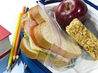 Sandwich, granola bar, apple, and pencils